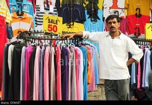 DFAK8T Man sells clothes on the main shopping street, New Delhi, India