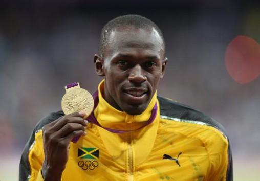 http://perpetuelle.wpengine.netdna-cdn.com/wp-content/uploads/2012/08/Usain-Bolt-Olympics-100m-Podium-Gold-Medal.jpg