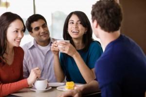 Friends talking in cafe