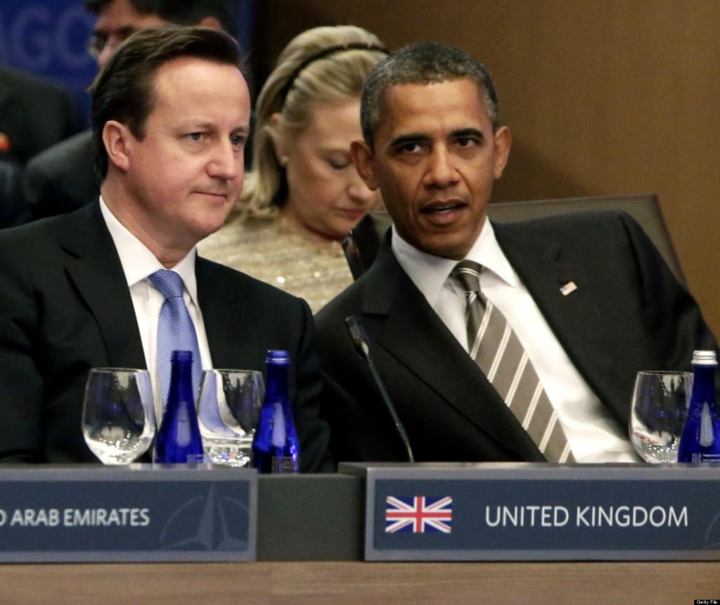 U.S. President Barack Obama speaks with British Prime Minister David Cameron